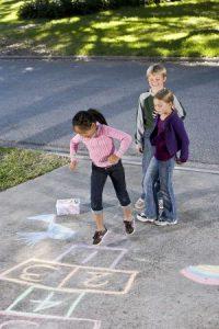 bigstock-kids-playing-hopscotch-10336232-e1483559385842